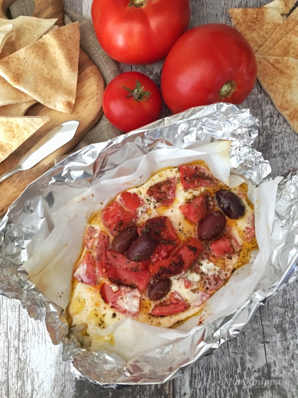 Warm feta packages, with tomatoes and olives