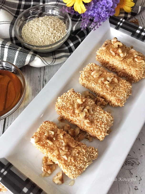 Sesame coated fried feta with honey and walnuts